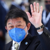 Foreign Minister Toshimitsu Motegi arrives to attend the G20 meeting of foreign and development ministers in Matera, Italy, on Tuesday. | REUTERS