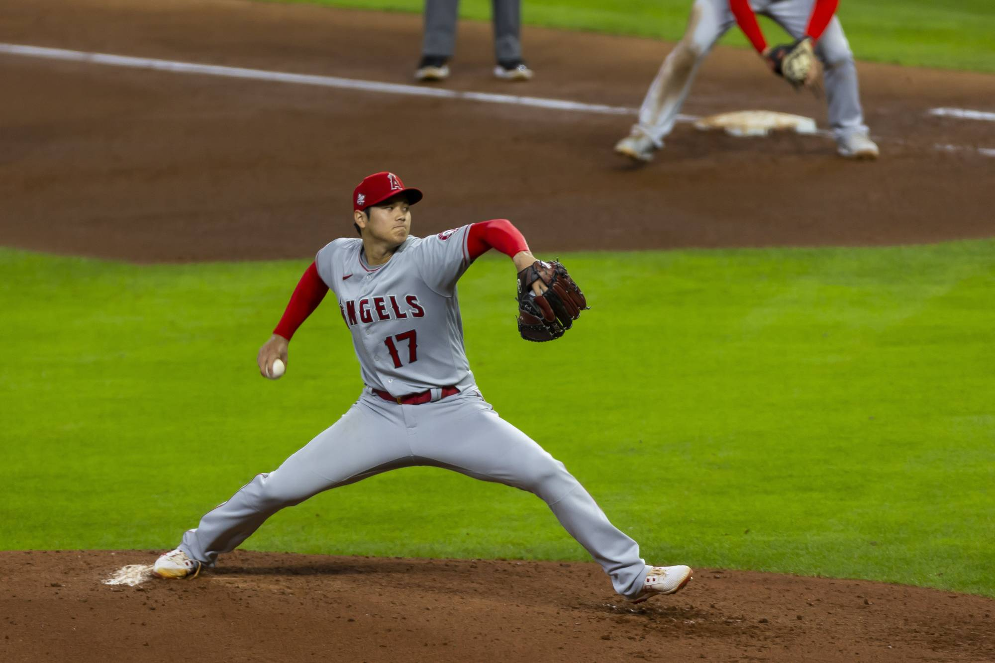 Angels pitcher Shohei Ohtani throws during a May 11 game against the Astros in Houston. | THE NEW YORK TIMES