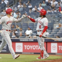 Ohtani (left) is greeted by Angels teammate Anthony Rendon after his third-inning home run on Tuesday. | KYODO