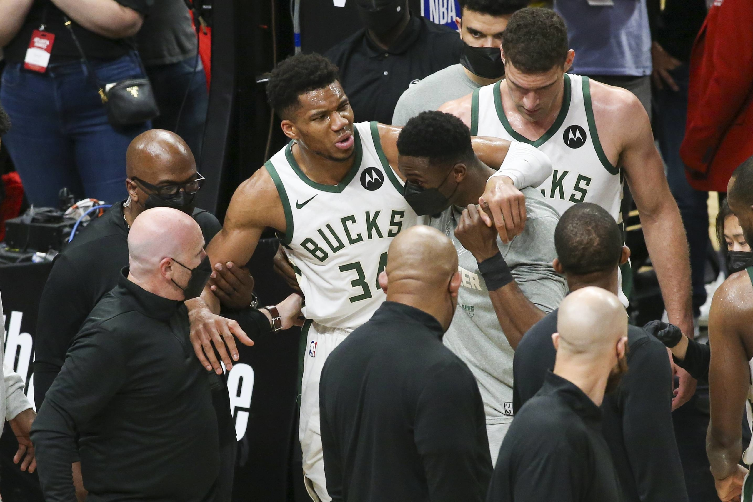 Bucks forward Giannis Antetokounmpo (34) is helped off the court after suffering an injury during Game 4 of the Eastern Conference Finals against the Hawks on Tuesday in Atlanta. | USA TODAY / VIA REUTERS