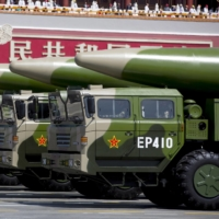 Chinese military vehicles carrying DF-26 ballistic missiles travel past Tiananmen Gate during a military parade to commemorate the 70th anniversary of the end of World War II in Beijing in September 2015.  | POOL / VIA REUTERS