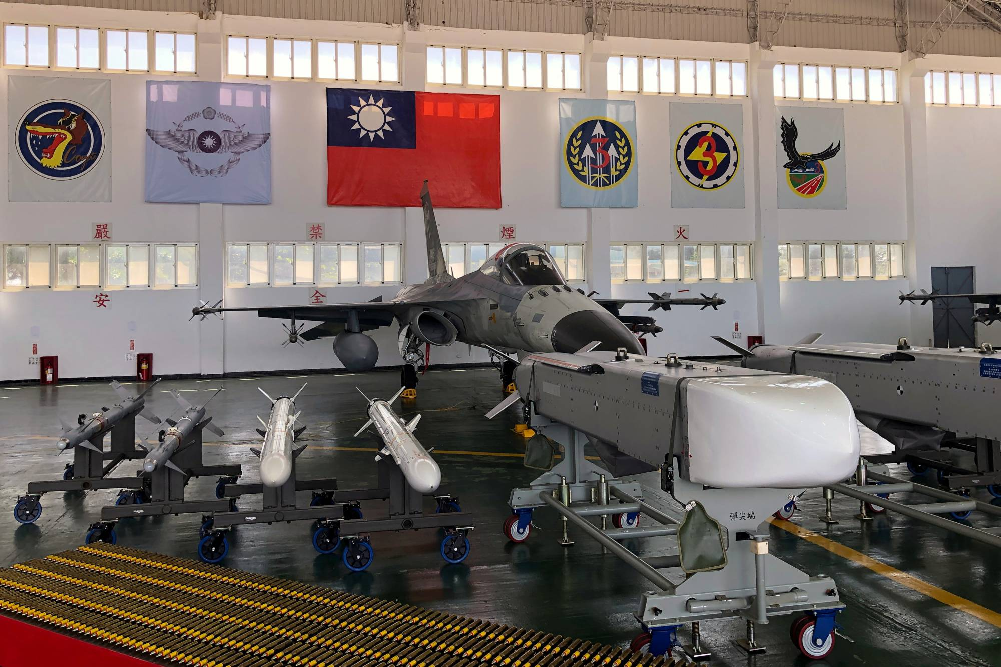 An Indigenous Defense Fighter (IDF) fighter jet and missiles are seen at Makung Air Force Base in Taiwan's offshore island of Penghu last September. | REUTERS
