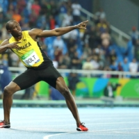 Usain Bolt does his famous lightning-bolt pose at the Rio de Janeiro Olympics in August 2016.   | REUTERS