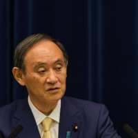 Prime Minister Yoshihide Suga speaks during a news conference in Tokyo on July 8. | BLOOMBERG