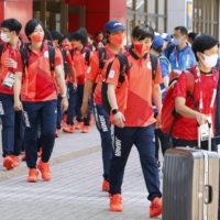 Members of the Japanese softball team arrive in the city of Fukushima on Monday before their first game on Wednesday.  |  KYODO
