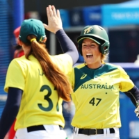 Michelle Cox and Rachel Lack of Australia celebrate during their game against Japan on Wednesday.  | REUTERS