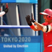 Japan's Minori Naito celebrates a home run in the opening game of Olympic softball on Wednesday in Fukushima. | REUTERS
