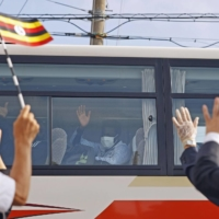 Members of the Ugandan Olympic team leave a hotel in Izumisano, Osaka Prefecture, on Tuesday to head for Tokyo for the Olympic Games. | KYODO