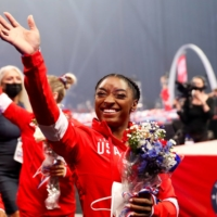 Simone Biles waves at fans during the closing ceremony of the U.S. Olympic trials in St. Louis on June 27.  | REUTERS