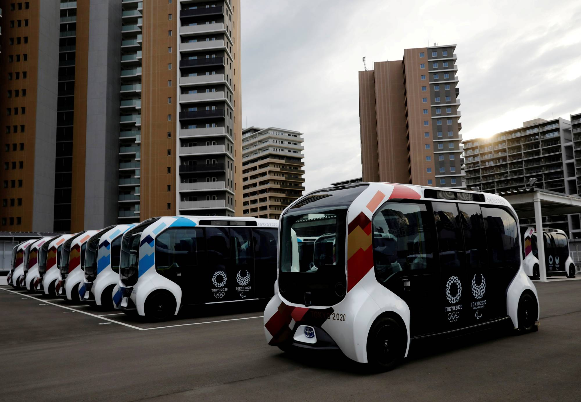 Electric vehicles are used for internal shuttle services at the athletes' village for the Tokyo Olympic and Paralympic Games.   REUTERS