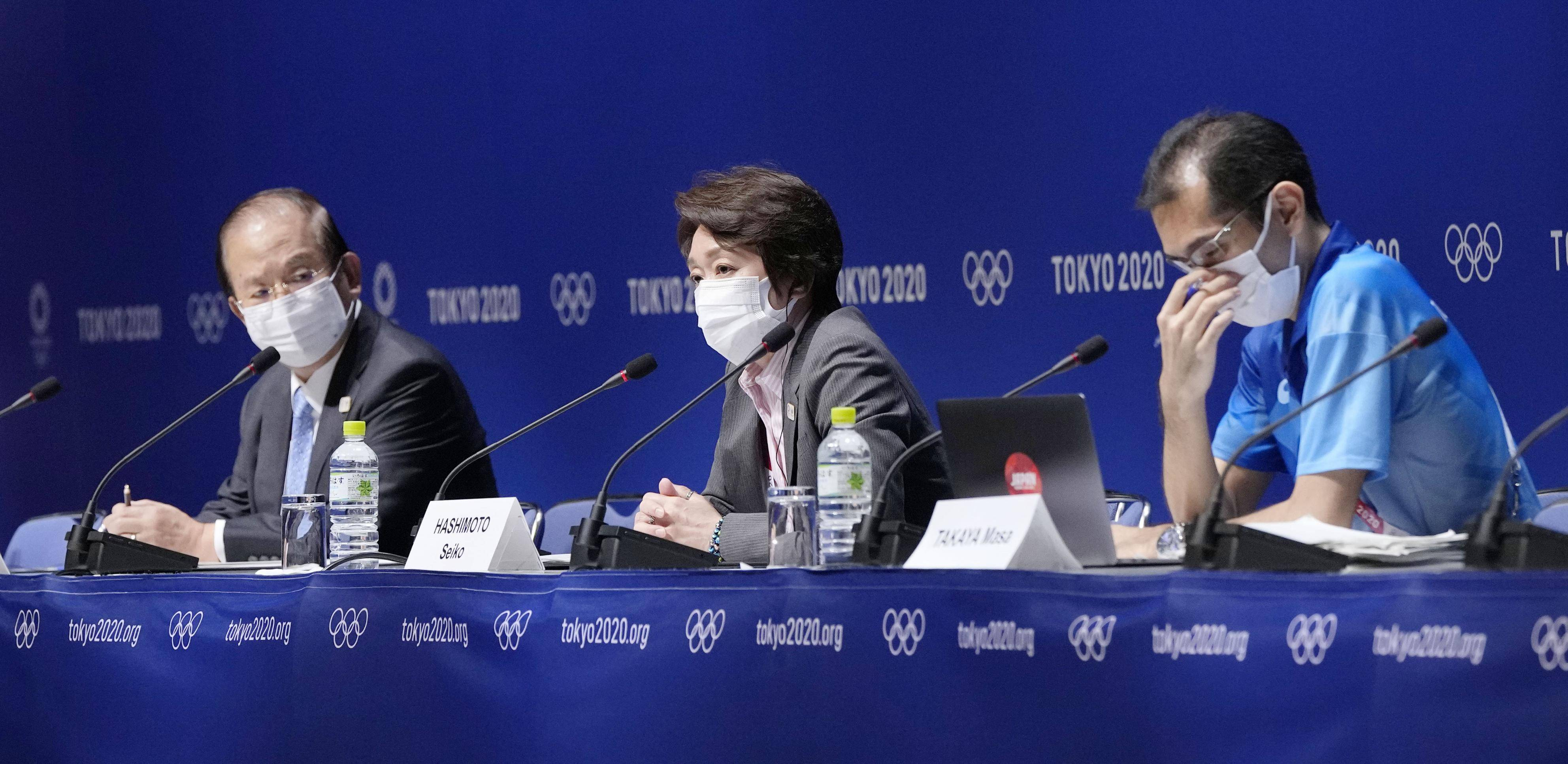 Seiko Hashimoto (center), president of the Tokyo Organising Committee, attends a news conference in Tokyo on Thursday. | TOKYO