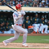 The Angels' Shohei Ohtani hits a double against the Athletics in Oakland, California, on Monday.   KYODO