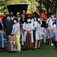 Tokyo reported 1,979 new COVID-19 cases on Thursday, the fifth highest daily tally ever in the capital. | REUTERS