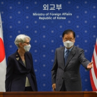 U.S. Deputy Secretary of State Wendy Sherman and South Korean Foreign Minister Chung Eui-yong talk prior to their meeting at the foreign ministry in Seoul on Thursday.  | POOL / VIA REUTERS