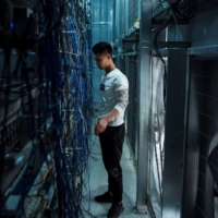 A worker adjusts cryptocurrency mining rigs at a facility in Dujiangyan, in China's southwestern Sichuan province. | AFP-JIJI