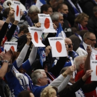 Turbine Potsdam supporters hold up placards in sympathy with Japan before the German women's cup final on March 26, 2011, in Cologne, Germany.   REUTERS