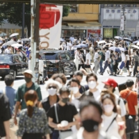 Crowded walkways in the Shibuya district of Tokyo on Thursday | KYODO