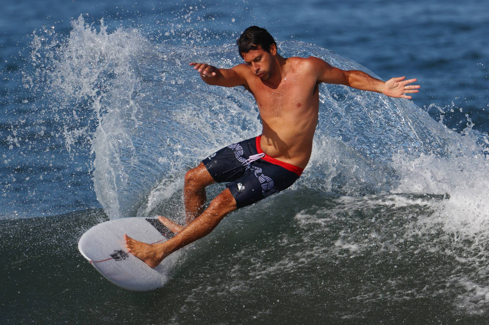 Michel Bourez of France in action during training on Friday at Tsurigasaki Surfing Beach in Chiba Prefecture.   | REUTERS