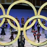 Performers assemble the Olympic Rings during the opening ceremony on Friday.  | AFP-JIJI