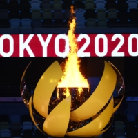 The Olympic flame burns after the lighting of the Olympic Cauldron during the opening ceremony of the Tokyo 2020 Olympic Games, | AFP-JIJI