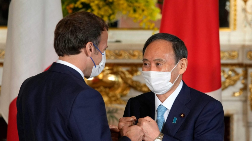 Suga meets with France's Macron as pair affirm security cooperation