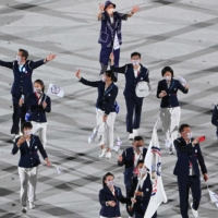 Taiwanese flag bearerers lead the delegation during the opening ceremony of the Tokyo Olympics at the National Stadium on Friday.