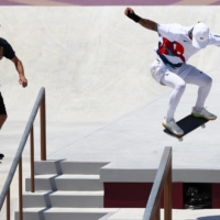 Skateboarding legend Tony Hawk films Nyjah Huston of the United States during training for the Tokyo Olympics at Ariake Urban Sports Park in the capital on Saturday.