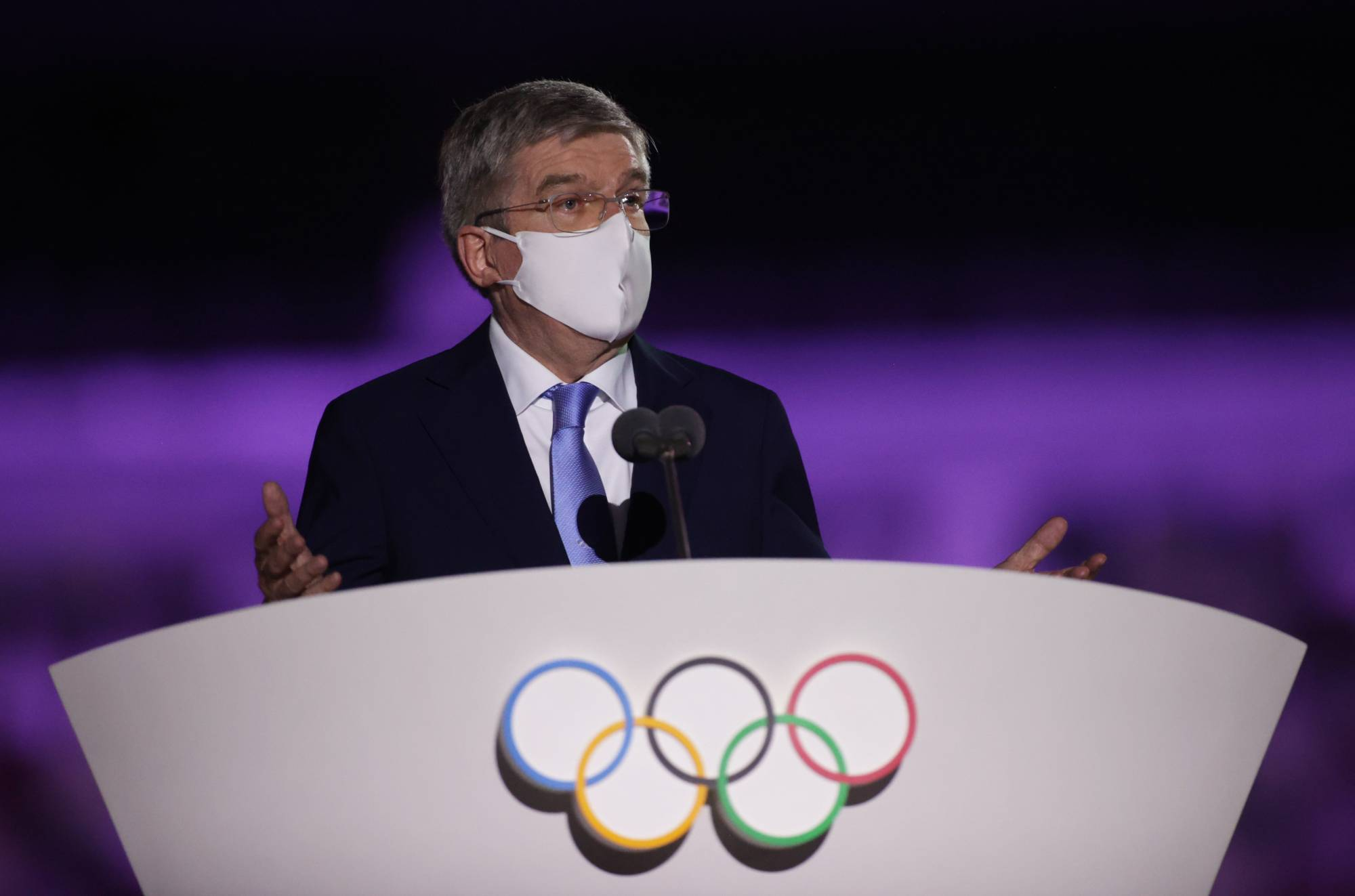 International Olympic Committee head Thomas Bach delivers a speech at the 2020 Tokyo Olympics opening ceremony at the National Stadium on Friday.  | REUTERS