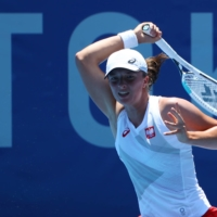 'It's different,' Poland's Iga Swiatek said of the heat after her 6-2, 6-2 win over German Mona Barthel. 'It's humid. In some places in the States it was probably similar, but still, I'm not used to it.' | REUTERS