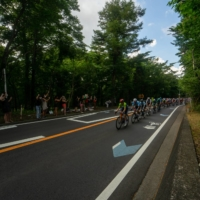 Near Lake Yamanakako, one of the Fuji Five Lakes, fans assembled along the roadside from as early as 8 a.m., hoping to get a brief glimpse of the peloton as it made its high-velocity pass through the area. | OSCAR BOYD
