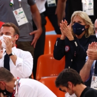 France president Emmanuel Macron and U.S. First Lady Jill Biden applaud as they attend the Basketball 3x3 match of U.S. versus France.  | REUTERS
