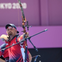 Team USA's Brady Ellison competes in the mixed team eliminations at Yumenoshima Park Archery Field in Tokyo on Saturday.