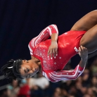 Simone Biles competes during the floor exercise at the U.S. Olympic women's gymnastics trials in St. Louis in June, where she earned a spot on her second Olympic team.    CHANG W. LEE / THE NEW YORK TIMES