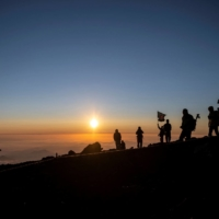 People watch the sunrise from the summit of Mount Fuji on July 19.   AFP-JIJI