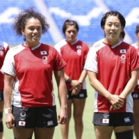 Members of Japan's women's rugby sevens team gather after a practice on Saturday at Kumagaya Rugby Stadium in Saitama Prefecture. | KYODO