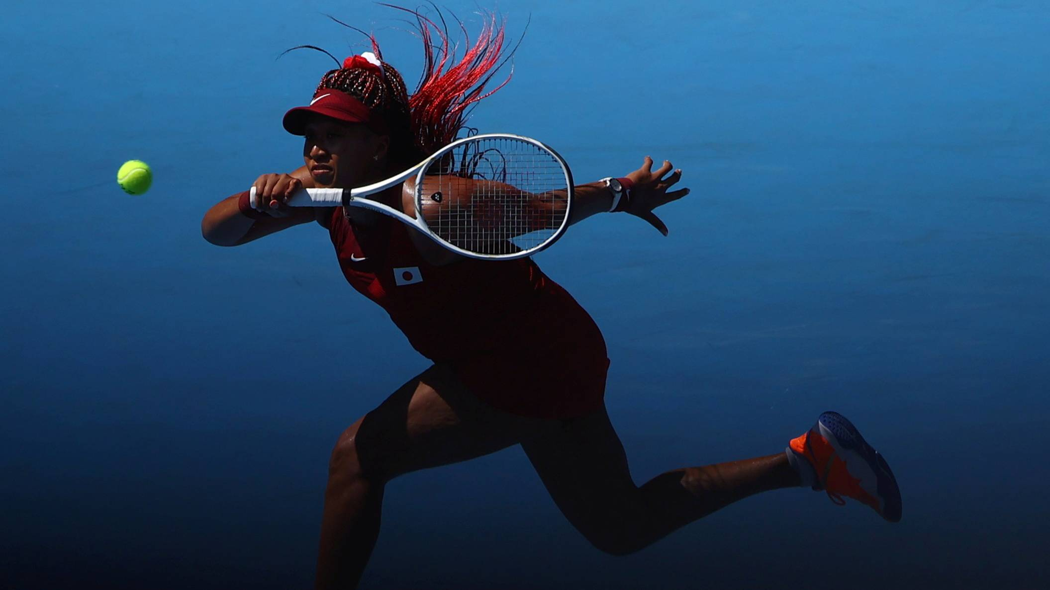 Naomi Osaka in action during her first-round match against Zheng Saisai of China. | REUTERS