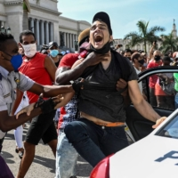 A man is arrested during a demonstration against the Cuban government in Havana on July 11.  | AFP-JIJI