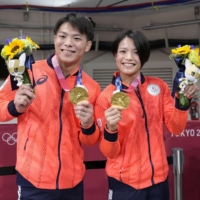 Judokas Hifumi Abe (left) and Uta Abe each won gold medals on Sunday in a historic night at Tokyo's Nippon Budokan.  | KYODO
