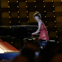 Japanese jazz pianist Hiromi Uehara gave a energetic performance at the Tokyo Olympics opening ceremony.   DOUG MILLS / THE NEW YORK TIMES