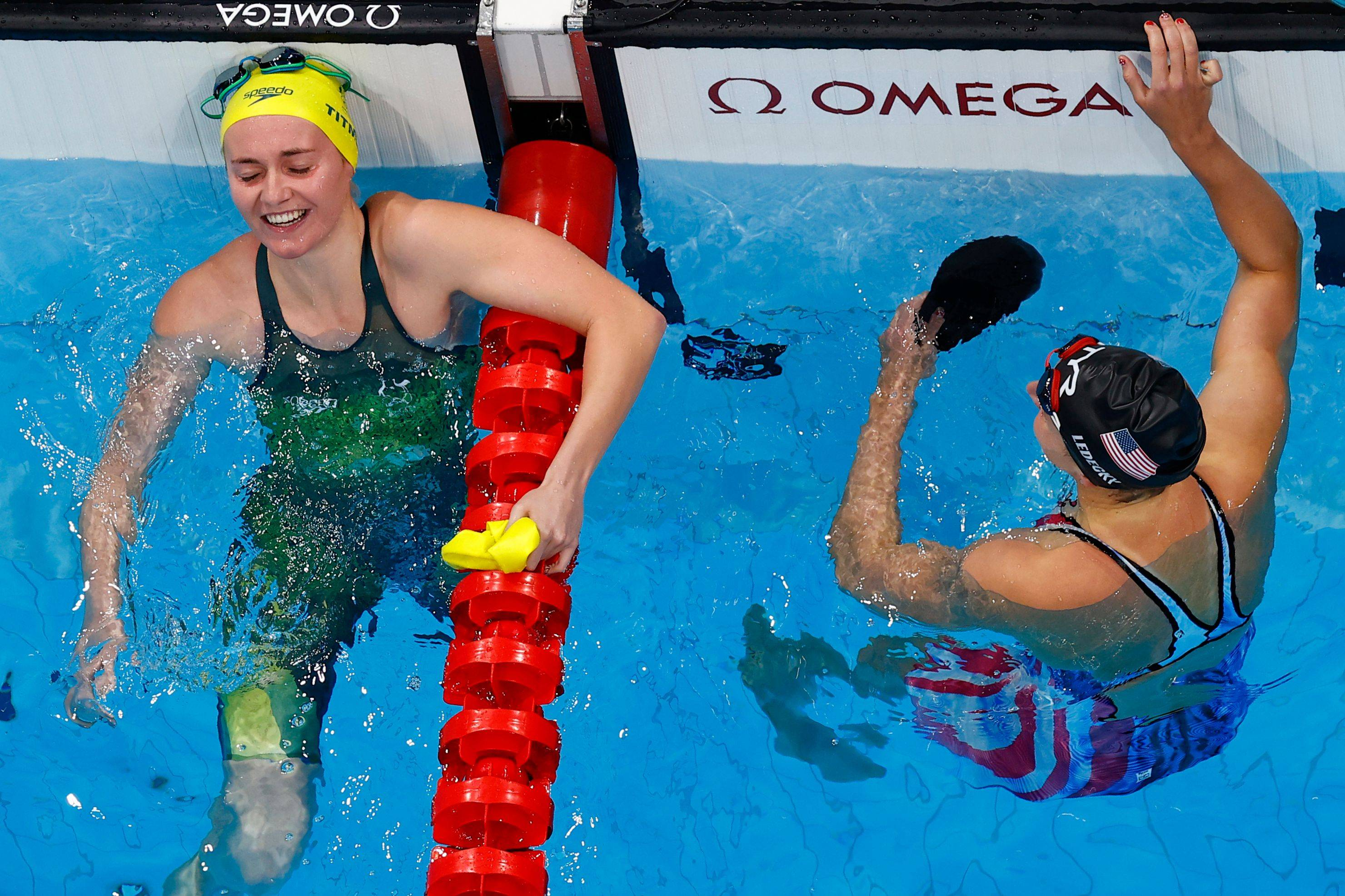 Ariarne Titmus of Australia (left) and Katie Ledecky of the United States after the women's 400-meter freestyle event. | REUTERS