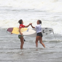 Sally Fitzgibbons of Australia shakes hands with Pauline Ado of France after their heat in the women's shortboard competition on Monday.  | REUTERS
