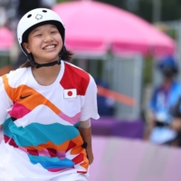 Momiji Nishiya of Japan smiles after one of her tricks in the women's street skateboarding competition in Tokyo on Monday.  | REUTERS