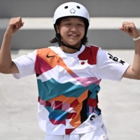 Japan's Momiji Nishiya celebrates after performing a trick during the skateboarding women's street final in Tokyo on Monday. The 13-year-old took gold in the competition.  | AFP-JIJI