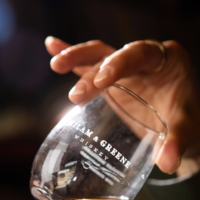 Heather Greene, one of the founders, holds a glass at the Milam & Greene distillery in Blanco, Texas, in May 2021. In just the few years since its founding, Milam & Greene has become one of the most highly regarded distilleries in Texas.   JESSICA ATTIE / THE NEW YORK TIMES