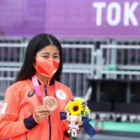 Japan's Funa Nakayama poses with her bronze medal during the medal ceremony on Monday in Tokyo.  | REUTERS