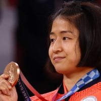 Fighting in her first Olympics, Tsukasa Yoshida earned a victory in the bronze-medal match over Eteri Liparteliani of Georgia.  | REUTERS