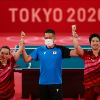 Japan's Mima Ito and Jun Mizutani celebrate after winning their mixed doubles Olympic gold-medal match on Monday in Tokyo.