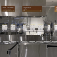 A serving area in the main dining hall during a media tour at the Olympic and Paralympic Village | BLOOMBERG