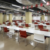 The casual dining room in the multi-function complex during a media tour at the Olympic and Paralympic Village | BLOOMBERG