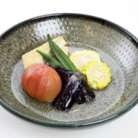 Oden, a standard Japanese winter menu item, is served in a chilled soup with tomatoes and other summer vegetables at the casual dining hall of the athletes' village. | TOKYO 2020 / VIA KYODO